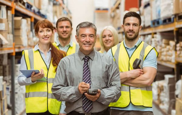 bigstock-Smiling-warehouse-team-with-ar-81084929